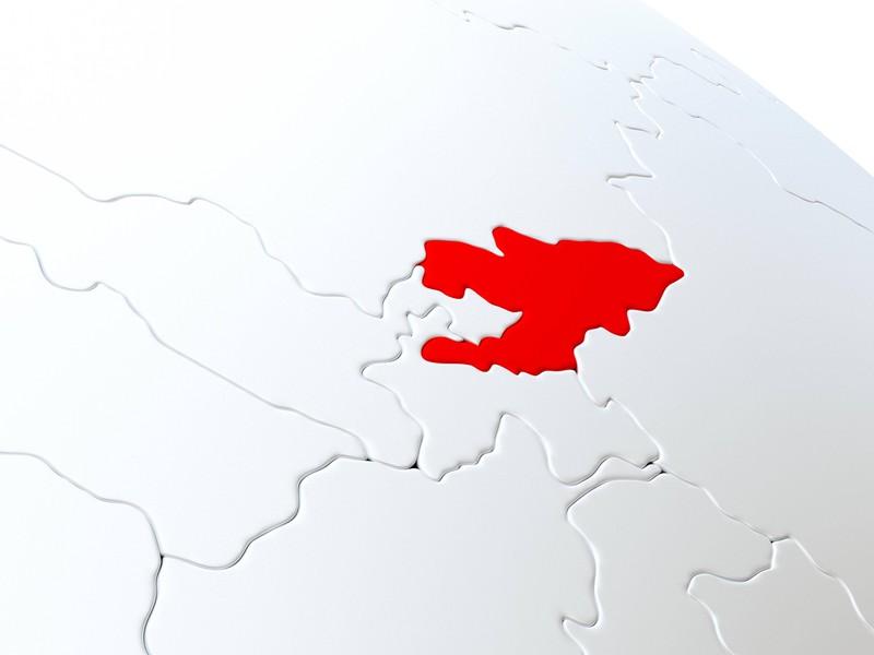 Die Silhouette eines Landes umgeben von anderen Ländern